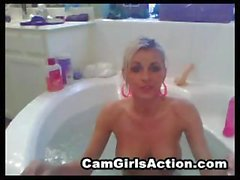 Busty blonde is being filmed in the bath and puts on a toy show
