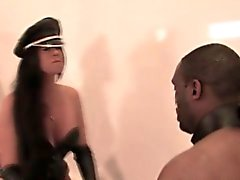 Leatherclad mistress dominates over black sub