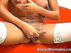 Esmeralda's a beautiful dark skinned shemale model with big