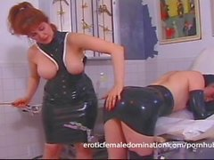 Mature redhead dominatrix shows her new slave what pain is