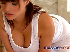 Massage Rooms Rita oils up her huge juicy breasts