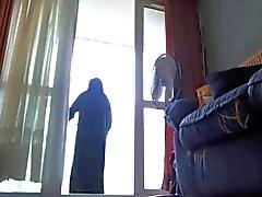 op mijn balkon in niqab