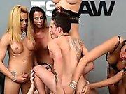 Guy gets gangbanged by five latin tranny pornstars