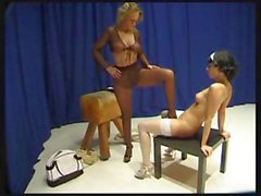 Amateur lezzies in sexy stockings put it on each other`s pussies