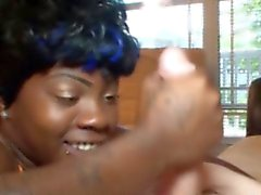 Tattooed nubian black skank tugging cock