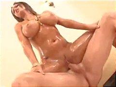Brunette Jenna Presley gets oiled up and gets both holes pumped