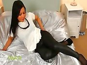 Brunette chick in black pants posing