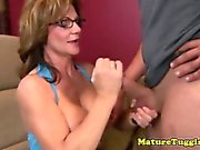 Amateur busty cougar MILF jerking dick