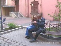 Russian young guy with his girlfriend and mom