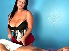 Hugetitted femdom massages clients cock