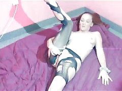 Petite gal having it out with her pantyhose and ripping it off