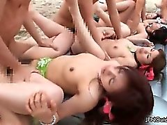 Horny groupsex fucking on a beach