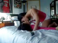 Two cute asian teens kissing and dry humping