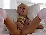 Blonde woman Emma Mae in sexy kneesocks