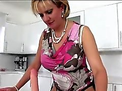 Mature british slut titfucks dildo