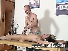 Hot gay scene Brit lad Oli Jay is roped down to the table, his sleek and