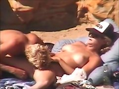 Milf doing a blowjob in the beach