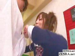 Naughty Japanese schoolgirl gives this dude a handjob in the hallway