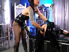 Latex Mistress destroys slaves ass with massive monster cock