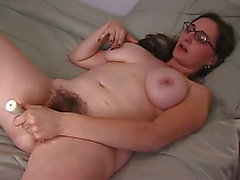 Natasha copulates her shaggy vagina with sex-toys