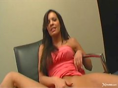 Vanessa Lane toying on chair