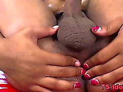 Black tgirl tugs cock and toys ass